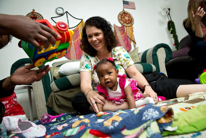Lauretta Jackson, a physical therapist from Any Baby Can, works with Sara weekly to improve her body strength. Nonprofit t...