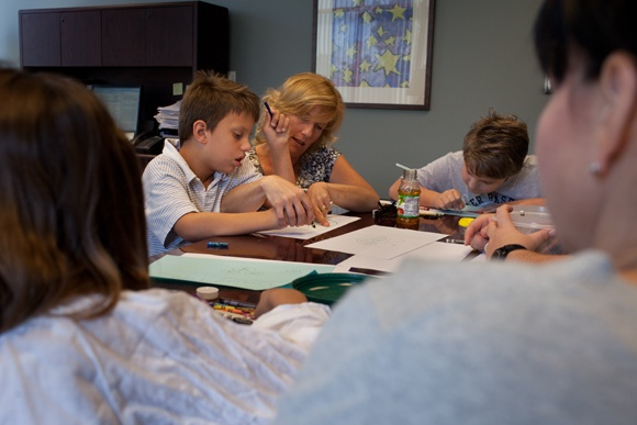 Karen Godfrey and her two sons Timothy Godfrey, and Zachary Munn draw and play together with Ishele Graves and her daughter Mikaela Massey at Bluebonnet Trails Community Services in Round Rock, TX.