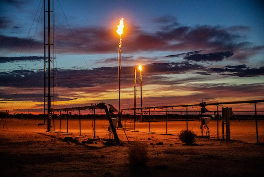 Oil field burn offs near Pecos, Texas. Until recently when the oil and gas market crashed, two lane highways were said to be…