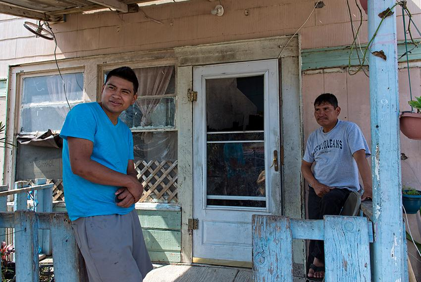 L to R:  Martin Gomez Jr. and his father Martin Gomez Sr. both work, but make so little that they aren't interested in buy...