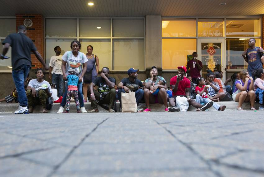 Large group of mostly African migrants outside a makeshift center in downtown San Antonio on June 26, 2019. The migrants a...