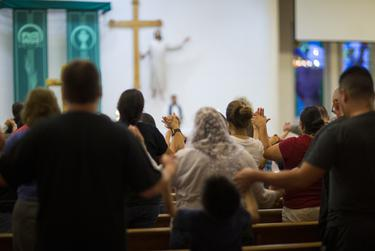 Parishioners are seen during a candlelight vigil at a Catholic church, Saturday, August 3, 2019, in El Paso, Texas. Photo by Ivan Pierre Aguirre