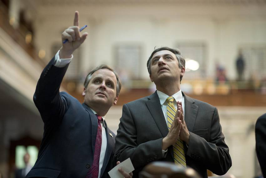 11:36 p.m. — State Reps Bryan Hughes, R-Mineola, left, and Giovanni Capriglione, R-Southlake, watch the voting board.