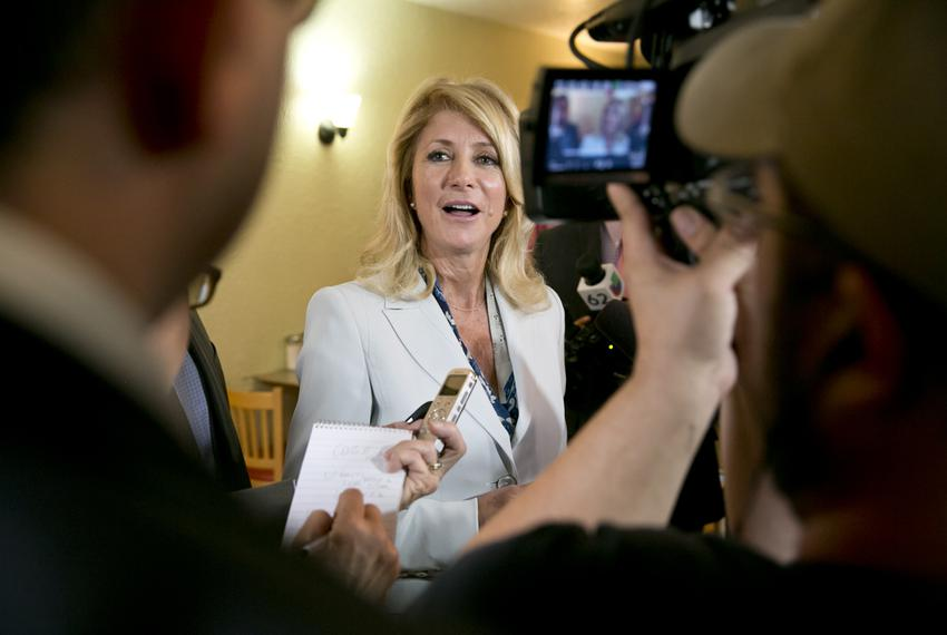 Democratic gubernatorial candidate Wendy Davis, speaks to media during a campaign stop at East Austin restaurant Juan in a M…