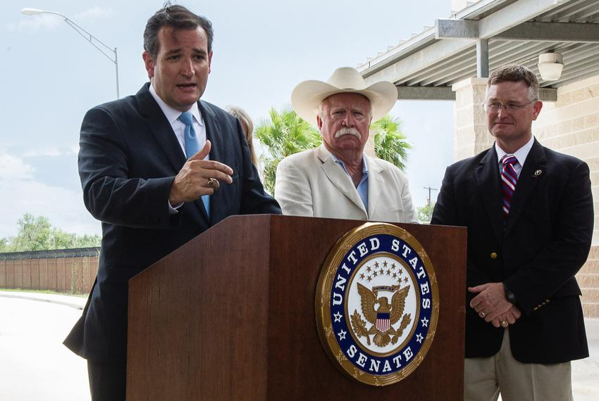 U.S. Sen. Ted Cruz holding a press conference at the Anzalduas International Bridge in Mission surrounded by a group of loca…