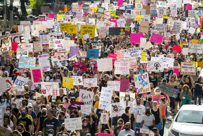 Thousands of participants march and with signs during the 2021 Women's March on Texas in downtown Houston on Saturday, Oct. …