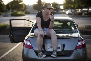 Karen Woodward speaks with her mother in a Walmart parking lot. The 42-year-old was living in her car after being evicted.
