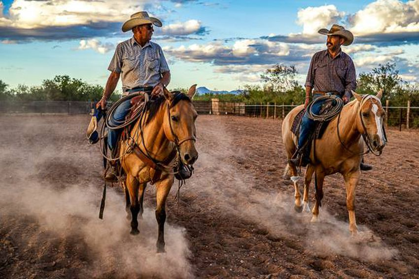 Bodie Means, 68, roping calves at a small horse arena in Valentine, Texas with his best friend Chuy Navarrete, 50. Water can…