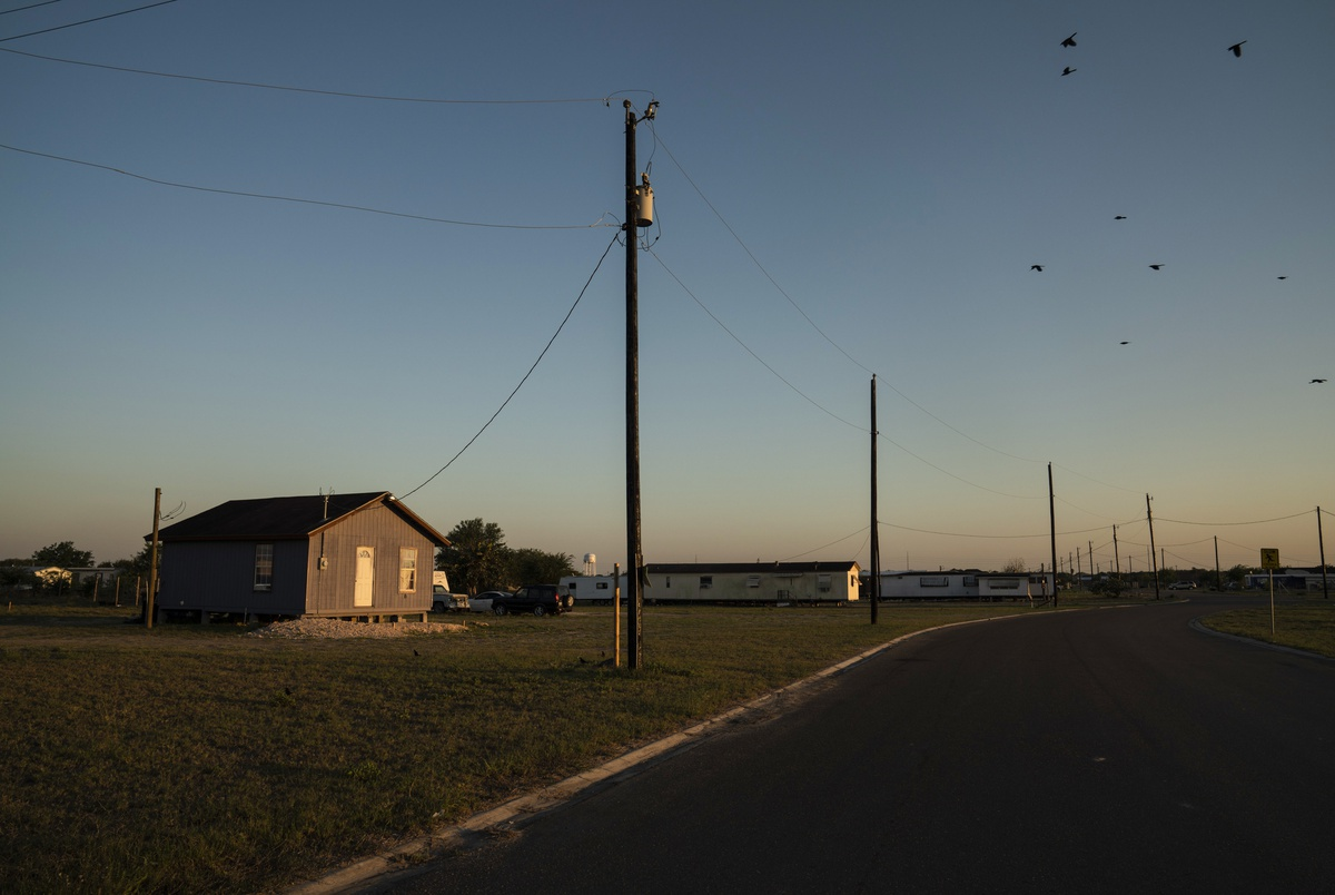 A colonia, unincorporated neighborhoods that lack basic services such as street lights, proper drainage, paved roads or waste management, is seen near Edinburg on March 25, 2020.