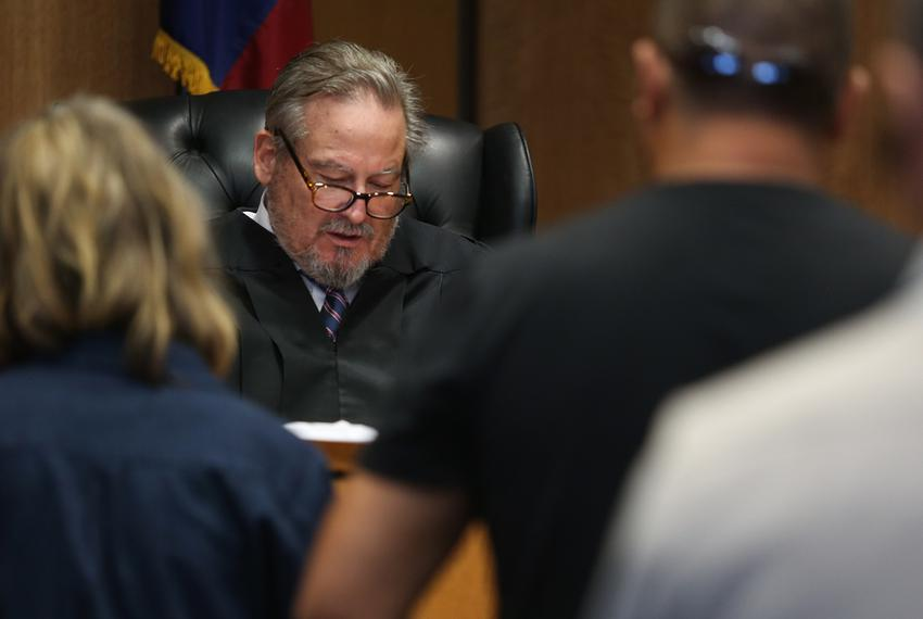 Travis County Judge Mike Denton describes the conditions — including the surrender of any guns — of a family violence prot...