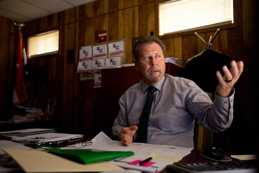 Don Tymrak, city manager of Karnes City, in his downtown office. He says the recent tumble in oil prices shouldn't affect th…