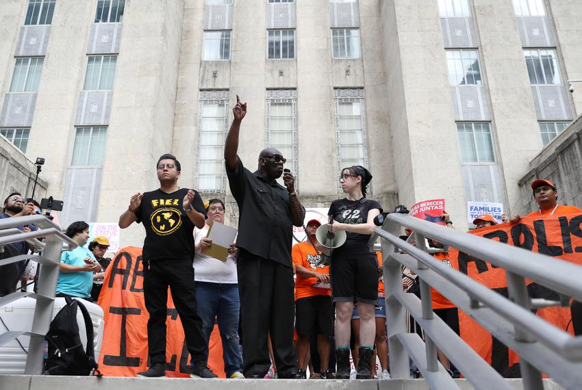 Ronnie Lister, president of the International Center for Spiritual and Social Activism, speaks to demonstrators protesting t…