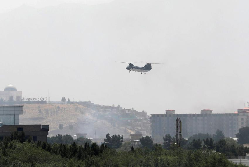 A U.S. Air Force CH-46 Sea Knight military transport helicopter flies over Kabul, Afghanistan, on Aug. 15, 2021.