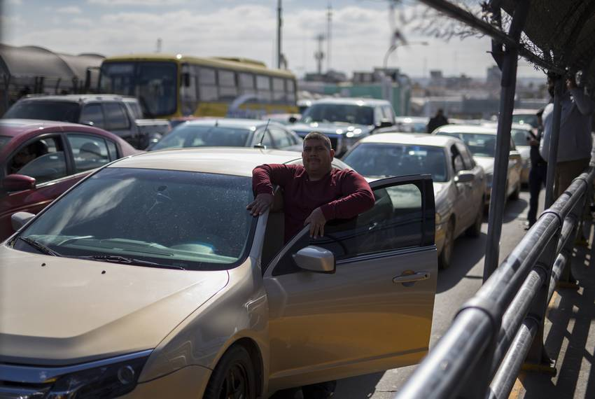 """A man waits outside his car as the CBP conducts """"operational readiness exercises"""" at the Paso del Norte Port of Entry on F..."""