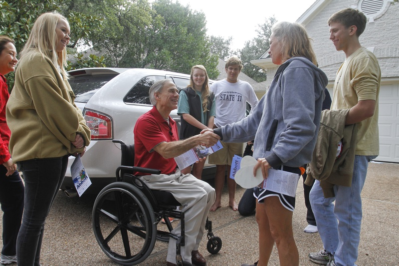 Audrey Abbott, left, joins her father, Attorney General and gubernatorial candidate Greg Abbott, to greet (from right) Matthew Tucker, Ellen Tucker, Michael Tucker and Joy Baughman during a block walk on Nov. 9., 2013, in Austin.