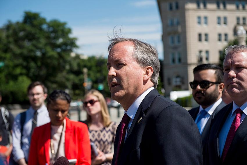 Texas Attorney General Ken Paxton holds a press conference on June 9, 2016 in front of the U.S. Supreme Court to discuss t...