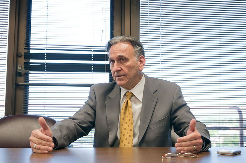 Texas Workers' Compensation Commissioner Rod Bordelon speaks to Texas Tribune reporter Elise Hu in 2010.