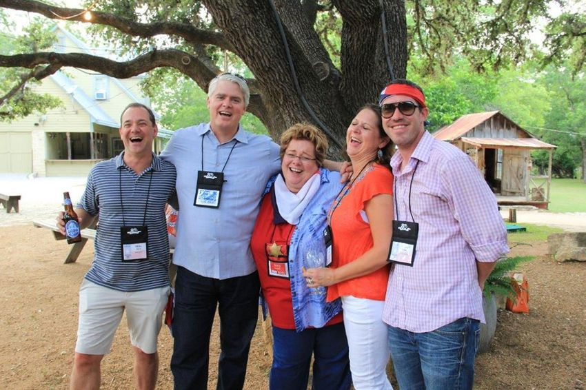 """Pictured second from left is liquor lobbyist Dewey Brackin. Next to him, in the center, is Amy Harrison, licensing director at the Texas Alcoholic Beverage Commission. The photo was taken in San Antonio at a conference of the National Conference of State Liquor Administrators. Brackin forwarded the photo to Harrison with the caption, """"Feeling no pain ..."""""""