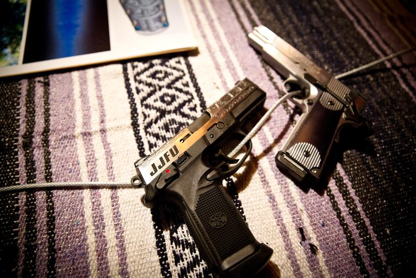 Handguns at a Jesse James Firearms Unlimited launch party in Austin.