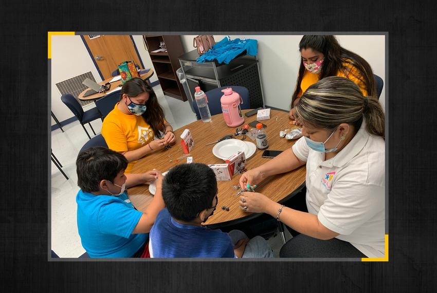 """Family Service Association volunteers work with students at a """"transition camp"""" for rising sixth and ninth graders."""