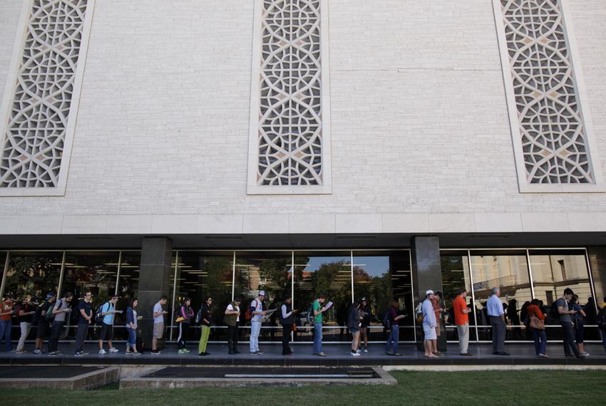 Voters wait in line to cast their ballots at the Flawn Academic Center on the University of Texas at Austin campus on Tuesda…
