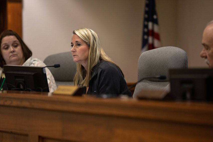 County Clerk Katie Lang listens motions for a two week suspension without pay after a vote allowed Election Administrator Mi…