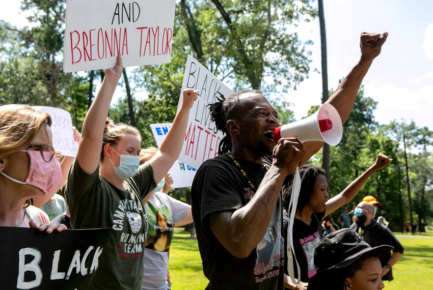Brother Emmanuel Thomas leads a chant during a rally for George Floyd in Vidor, Texas on June 06, 2020. Organizers of the ra…