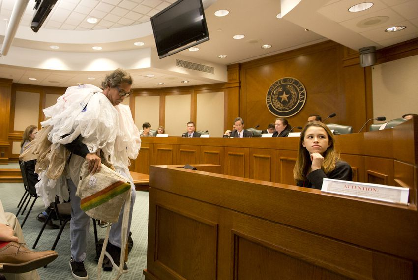 """Joseph Seinsheimer, chairman of the Galveston chapter of the Surfrider Foundation, dressed up as a self-proclaimed """"bag monster"""" with dozens of plastic bags wrapped around his upper body. He testified Tuesday against legislation that would would prevent cities from banning plastic bags."""