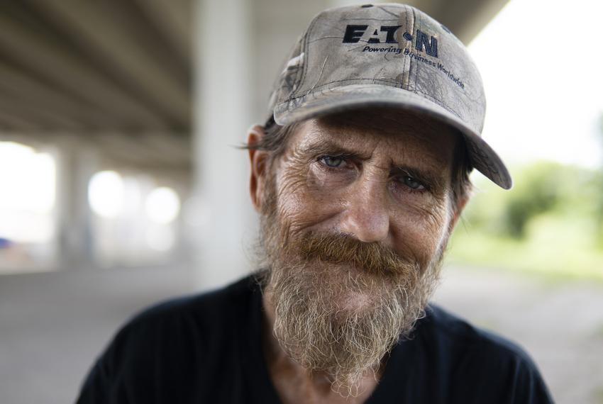 Derek Lorentzson, 48, sits in front of his tent underneath Ben White Blvd. in Austin on July 27, 2021. He has been unhoused …