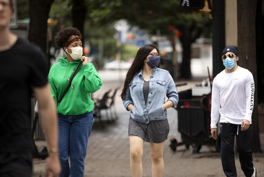 Pedestrians wearing masks to protect against COVOD-19 in downtown Austin on June 24, 2020.