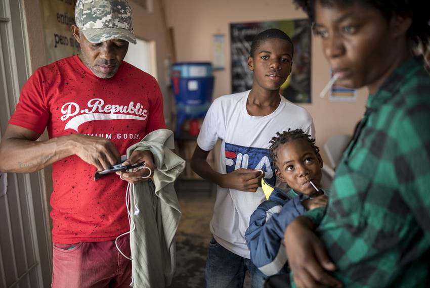 From left: Roberto Kabuya Mutombo of the Congo with his family Lucas, Acacia, and Sara at El Buen Pastor migrant shelter o...