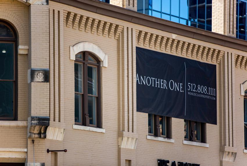 """Another One"" banners by the World Class Capital Group are up across downtown Austin to mark their recent acquisitions. The …"