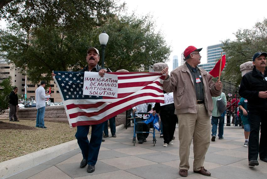 Demonstrators stand in front of the Texas Capitol on Feb. 22, 2011 to show their opposition to immigration legislation.