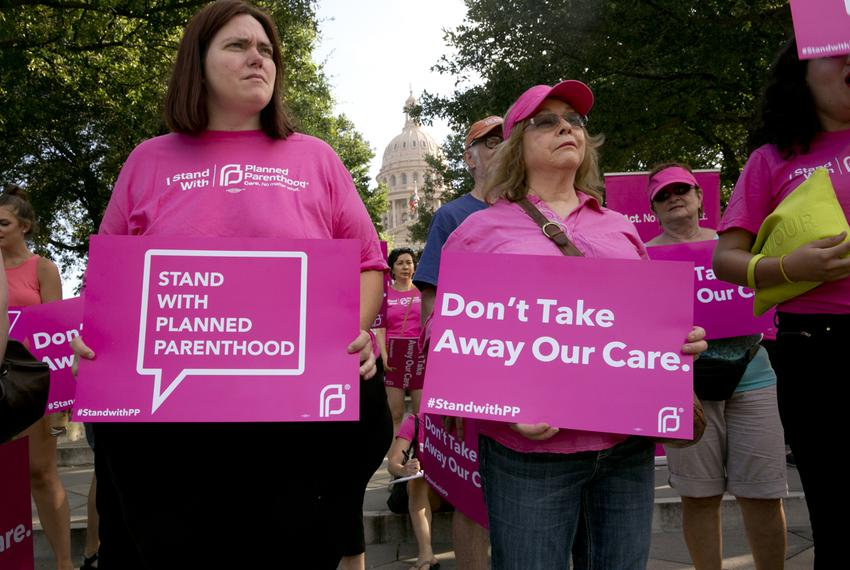 Planned Parenthood supporters rally outside the Texas Capitol on July 29. State health officials announced they want to kick…