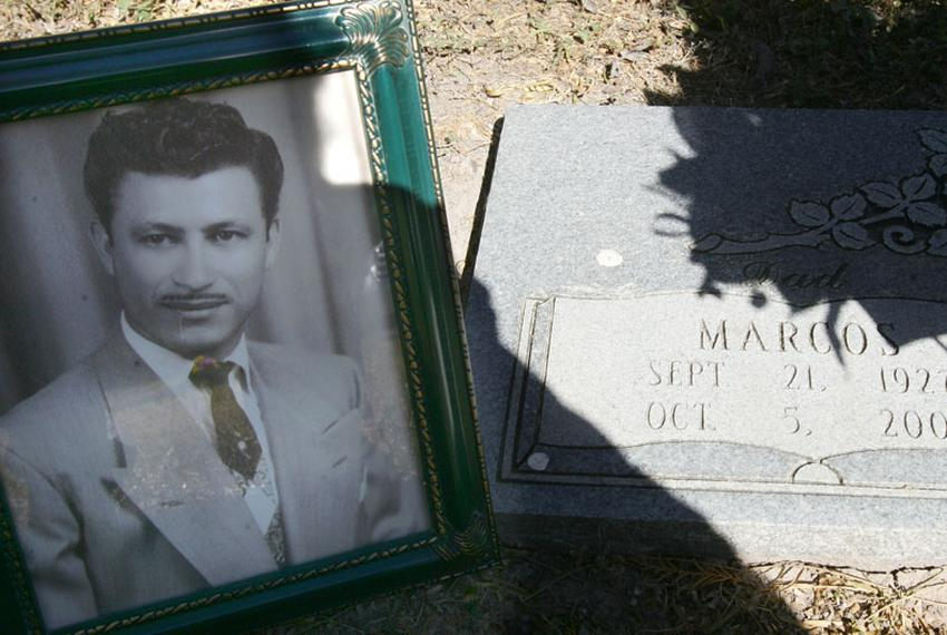 A photograph of Marcos Guerra at the gravesite in San Benito, Texas.