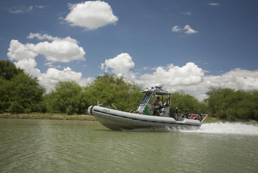 A U.S. Customs and Border Patrol boat heads south in the Rio Grande River between Hidalgo and Los Ebanos in Hidalgo County...