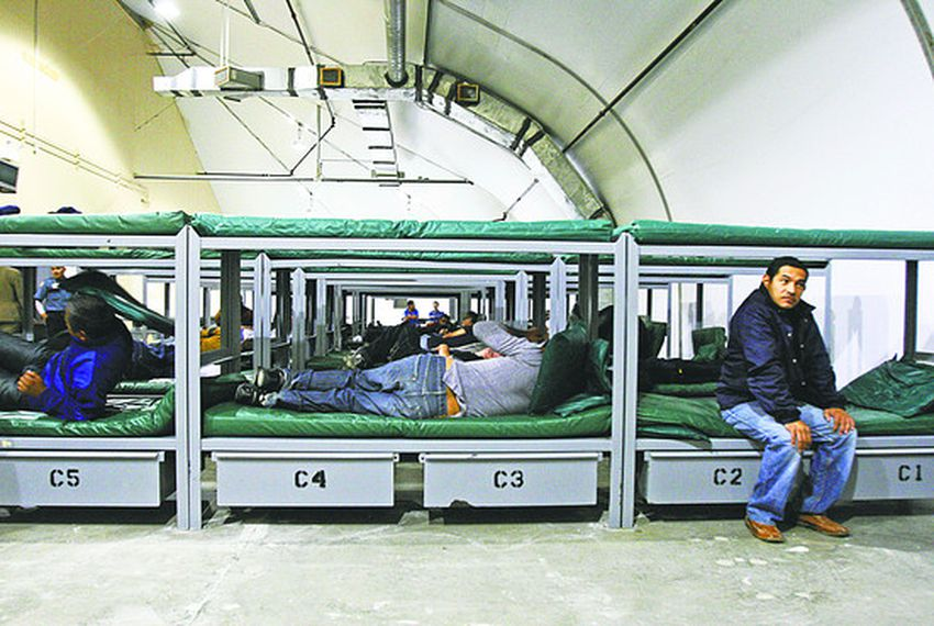 Detainees and bunk beds inside the Willacy Immigration Detention Center.