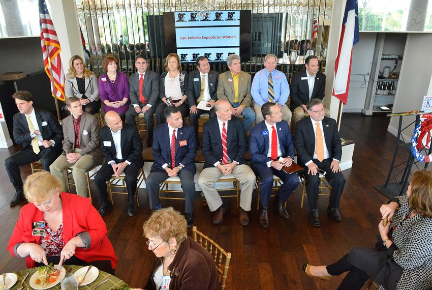 Fifteen of the 18 Congressional District 21 GOP primary candidates wait to begin the San Antonio Republican Women's candidat…
