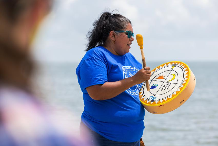Love Sanchez, of the Indigenous People of the Coastal Bend, participates in a prayer ceremony at McGee Beach in Corpus Chris…