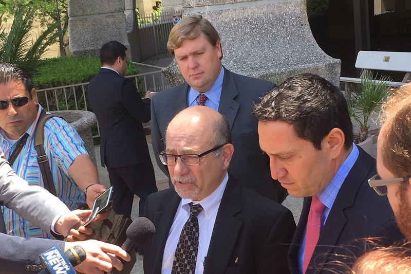 Jose Garza, an attorney for the Mexican American Legislative Caucus, and former Texas Rep. Trey Martinez Fischer speak to reporters on April 27, 2017, following a status conference on a years-long challenge to Texas' political maps.