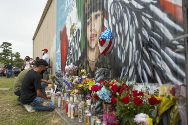 Juan Cruz kneels in front of a mural honoring his girlfriend, Army Specialist Vanessa Guillén, on Sunday, July 5, 2020.