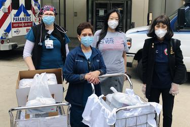 Debbie Chen, second from right, and Stafford City Council member Alice C. Chen, right, deliver meals from local Asian restaurants, including Debbie Chen's, to nurses at Houston Methodist Hospital.