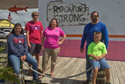 Danielle Hale (pink shirt) is joined by her family (left to right) Gillian Hale, 14, Wyatt Hale, 17, Micah Hale and Conner Hale, 8, in Rockport's Historic District on August 11, 2018. Hale was named a StormReady Community Hero by the National Weather Service.