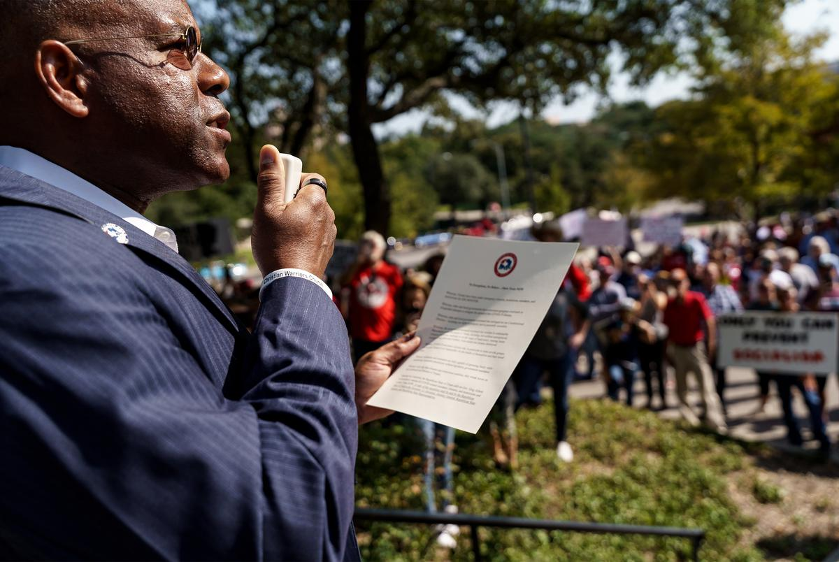 State GOP Chairman Allen West speaks to protestors gathered at the Governor's Mansion to protest Gov. Abbott's executive orders closing businesses and mandating masks.