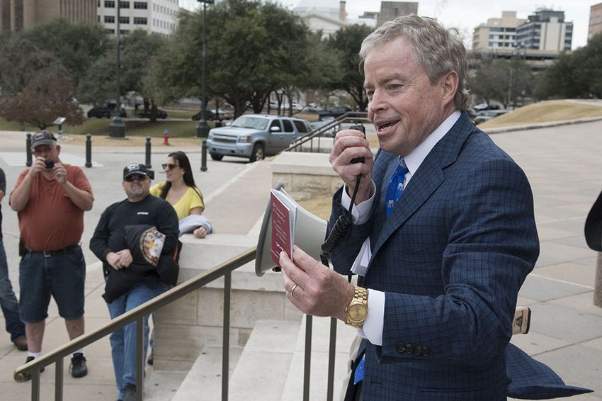 Sen. Don Huffines, R-Dallas, shows his copy of the U.S. Constitution during the Open Carry Texas rally Jan. 13, 2017 at the Texas Capitol.