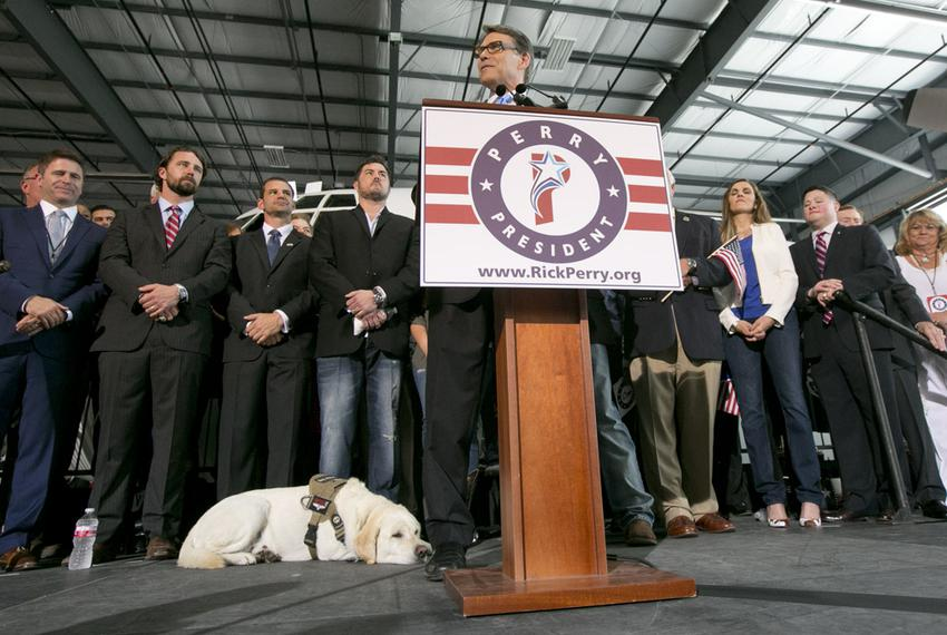 """Lone Survivor"" Marcus Luttrell's service dog Rigby takes a breather during Perry's speech."