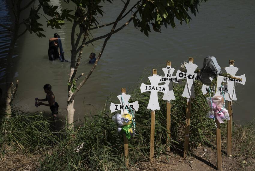 Memorial crosses left on the banks of the Rio Grande in honor of those who lost their lives trying to cross to the U.S. th...