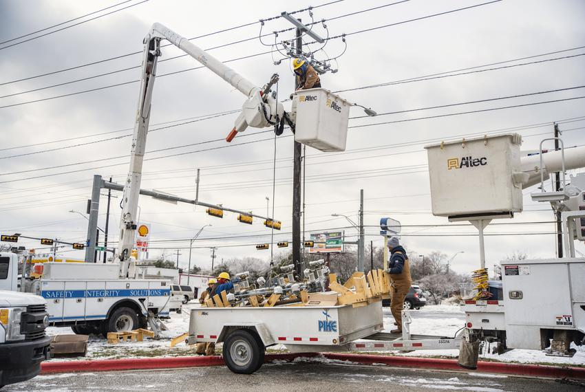 Electrical workers repair a power line in Austin on Feb. 18, 2021. Many Texas residents are still without power, and many do…