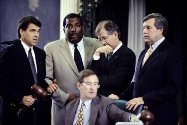 Photos COPYRIGHT Bob Daemmrich 1997, 1999, 2001.  All rights reserved. Sen. Royce West in action at the Texas Senate. Year is shown in the file name.   Talking with left to right, Rick Perry, Royce West, Teel Bivins and Troy Fraser.