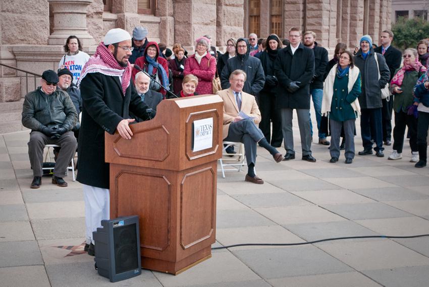 Imam Islam Mossad of the North Austin Muslim Community Center recites the Islamic call to prayer to start Texas Impact's int…